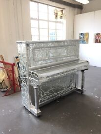 Piano mosaic covered in mirror tiles