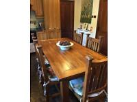 Light oak table and 6 matching chairs for sale