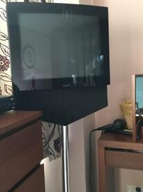 Bang and Olufsen TV with tall stand