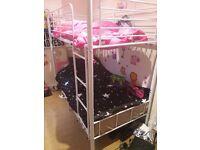 White metal frame bunk beds