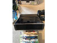 Xbox 360 console with games and controllers