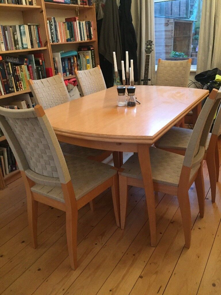 Extendable light wood dining table, seats 6 – 10