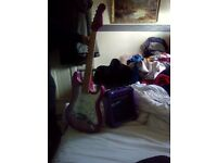 Girls pink eletric guitar with amp