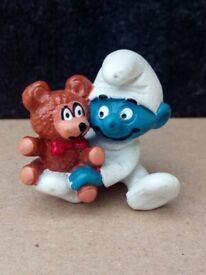 Peyo vintage baby smurf holding teddy bear figurine