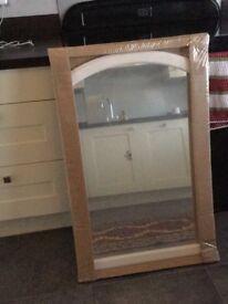 Ikea mirror. Still in the packaging.