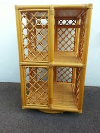 Cane storage unit which has ornate design with revolving turntable.