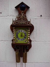 Dutch wall clock in excellent working condition,delivery an option