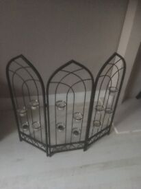 Ornamental fire screen with tea ligho