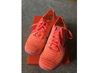 Orange Nike free run flyknit trainers, size eu38 uk4.5