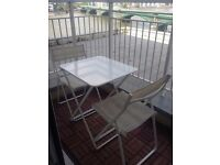 Ikea Outdoor table and 2x chairs in white. Very comfy chairs