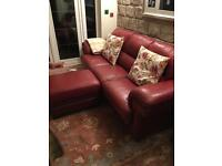 Red leather sofa and foot stool