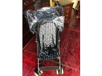 Black patterned buggie good condition