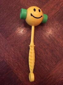 Smiley face baby rattle