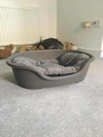 Plastic grey dog bed (60cm) with plush cushion.
