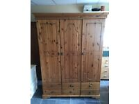 3 DOOR 6 DRAWER PINE WARDROBE WITH HANGING RAIL AND SHELVES IN VERY GOOD CONDITION , MEASURES 55 INC