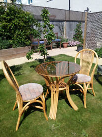 Rattan glass top table and 2 chairs