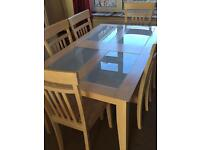 Limed oak 6 seater dining table and chairs. Glass panels