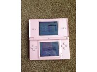 Pink Nintendo ds lite with 2 games