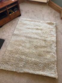 Cream/beige large shaggy rug