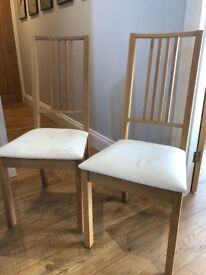 Pair of chairs, pale wood finish with white upholstery