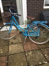 Ladies retro blue bike with basket