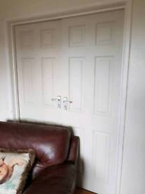Double wooden panelled doors