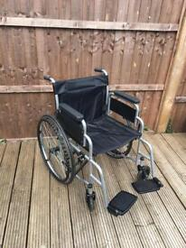 Folding self propelled wheelchair