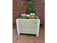 Handmade 32cm rectangle decking planter with plastic trough included.