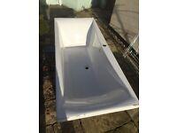 White bath and two white basins