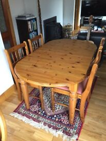 4 chairs and pine extending table 74 high x 90 wide x 154/191 cm long. Chair seats upholstered