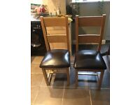 Two sturdy wooden dining room chairs