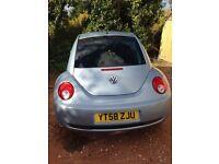 Light blue Volkswagen Beetle. Excellent car. Lady owner