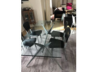 Designer Glass Table and four leather chairs