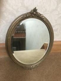 Antique Gilded, Decorated Oval Mirror with bevelled edge