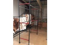Warehouse racking for clothing on hangers