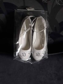 Brand new. Never worn. Flower Girl shoes. White. Designed by Marylebone London. Size 4.