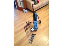 Set child's golf clubs and trolley