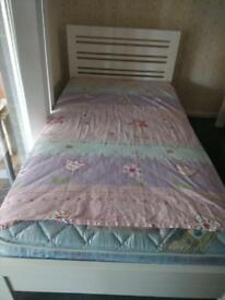 Small bed and mattress.