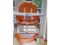 Hardly used high chair in bright orange