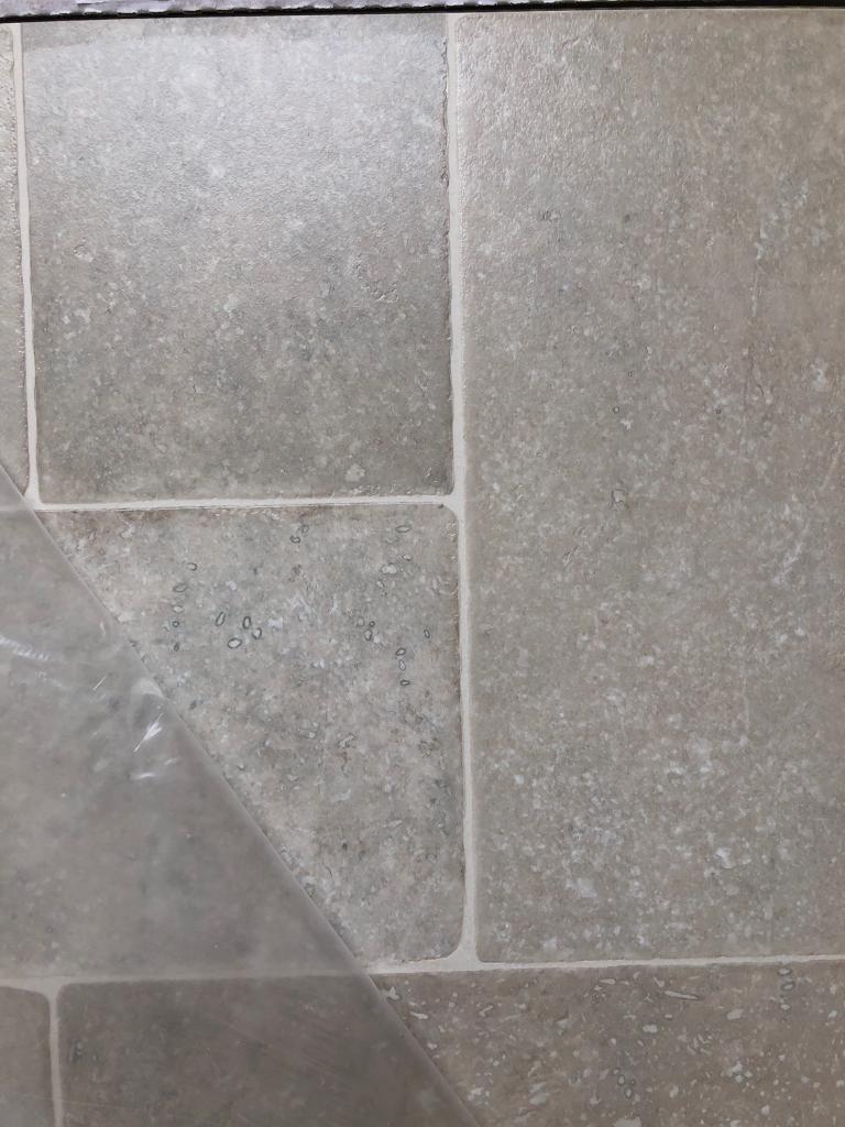 13 02m2 Random Limestone Tile Effect Laminate Flooring