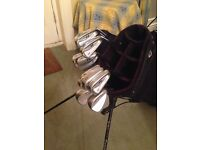Golf clubs, Irons, wedges and a stand bag