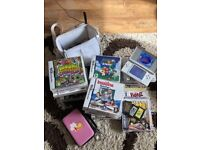 White DS Lite Console and assortment of games
