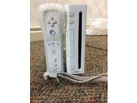 Nintendo Wii with 3 games included. The games are Wall.E , Spider Man 3 and Downhill Jam