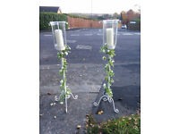 Pair of 1m tall white candle stands with white rose garland. Wedding / Christmas decorations