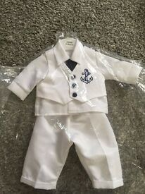Boys Christening outfit. Beautiful silk outfit as new, worn for only one hour. Cost over £60.