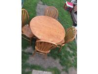 Sold wood round dining table
