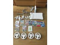 Nintendo wii Mario bundle wii fit X4 controllers and steering wheels