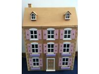 Wooden Dolls House with electric lights.