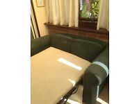 Green sofa bed in good condition