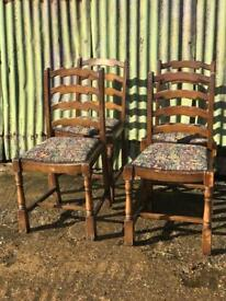Four vintage wooden ladder back chairs